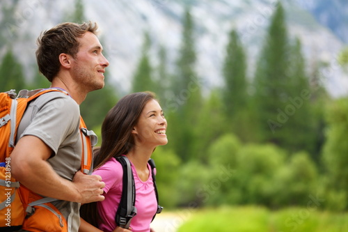 Couple - active hikers hiking in Yosemite