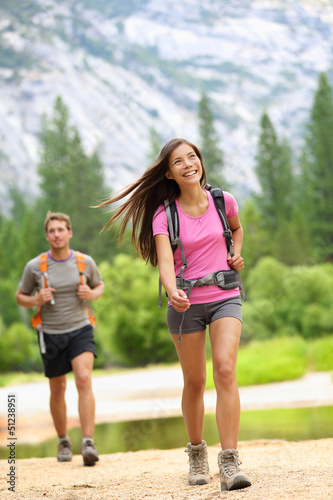 Hiking people - couple hikers happy in Yosemite