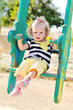 toddler girl on swing