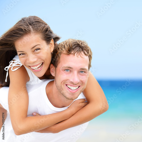 Happy couple on beach summer fun vacation