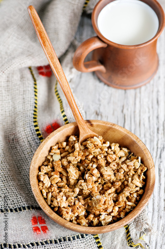 Muesli in wooden plate and milk