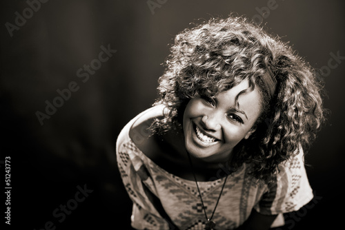 Beautiful black woman on black background. Studio shot