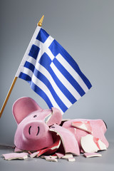 Robbed piggy bank with Greece flag