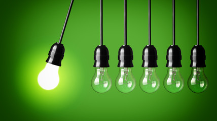 Idea concept on green .Perpetual motion with light bulbs