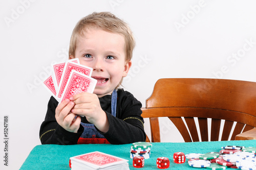 little boy playing poker