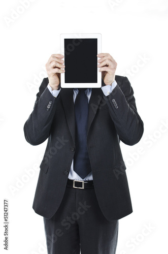 businessman holding Ipad in front of his head