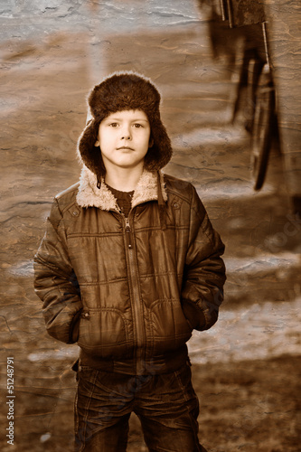 Retro black and white photo of sepia Boy homeless bum in brown j