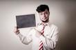 businessman with a blank blackboard
