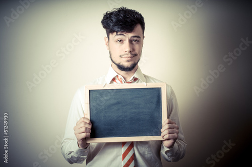 businessman with a blank blackboard