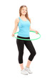 Full length potrait of a young female athlete exercising with a