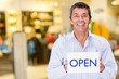 Business owner with an open sign