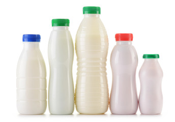 Composition with plastic bottles of milk products