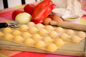 Homemade raviolis with ingredients.