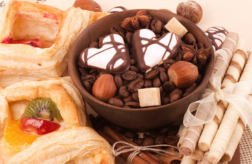 Coffee beans and cinnamon, nuts, sweetness