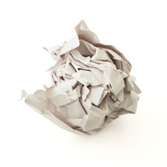 Crumpled gray paper ball over white background