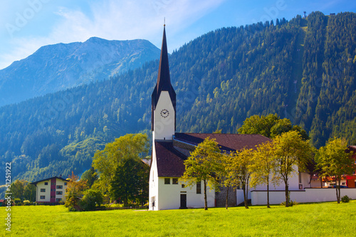 Alps village with cathedral