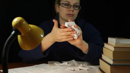 Angry woman crumpling paper