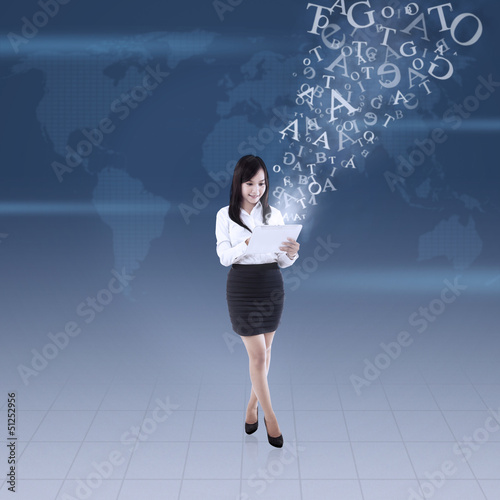 Businesswoman send email globally