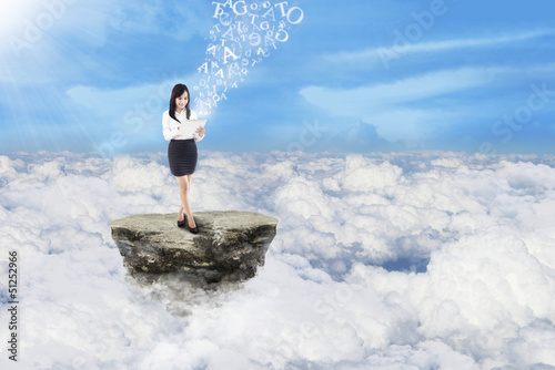 Businesswoman send message on clouds