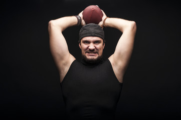 Young Sportsman in studio on Black Background  ball