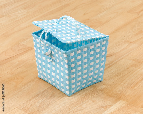 Weaved plastic baskets with a lid for storage stuff or laundry