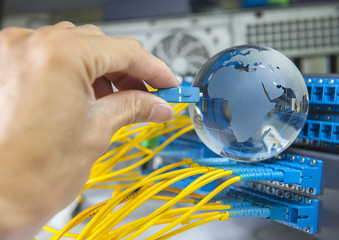 globe with network cables and servers in a technology data cente