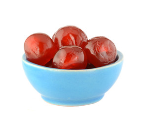 Glace cherries in ceramic bowl