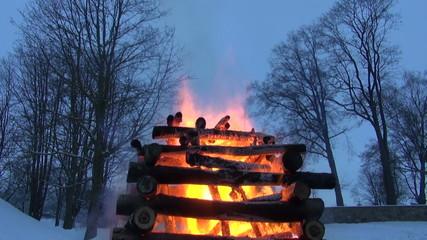 spring equinox celebration march mardi gras fire in evening