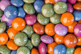 Colorful chocolate candies on table