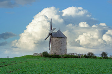 Traditional old windmill in Normandie, France