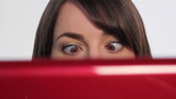 Woman at computer. Crossed eyes.