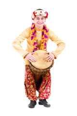 full length portrait of indian man with a drum
