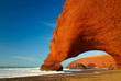 Red archs on atlantic ocean coast. Marocco