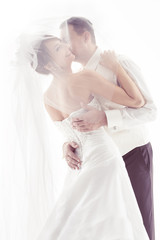 Wedding couple kissing and happy smiling. Bride portrait