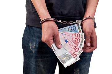 man in handcuffs is holding money over white background