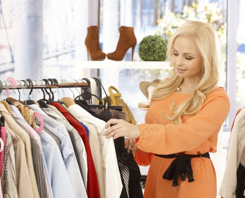 Young woman at clothes store