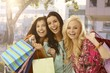 Shopaholic female friends smiling happy