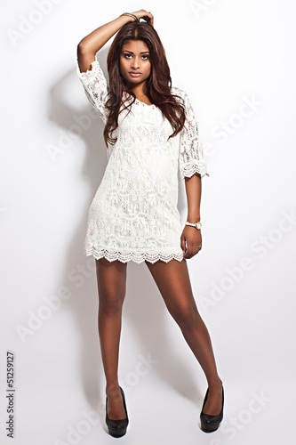 latina beauty wearing white dress