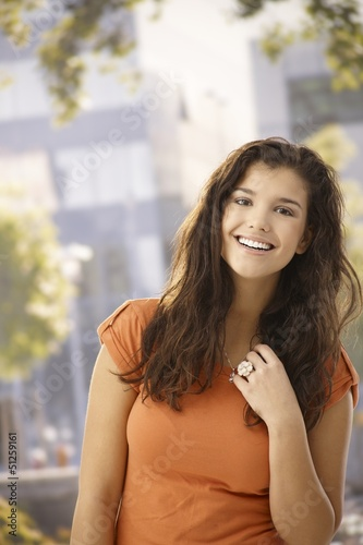 Outdoor portrait of happy girl