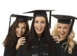 Closeup portrait of happy female graduates