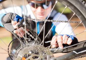 Young Man Repairing Bicycle Wheel