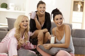 Girls watching tv at home