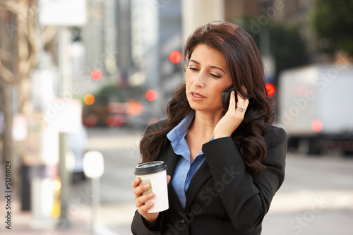 Businesswoman Outside Office On Mobile Phone