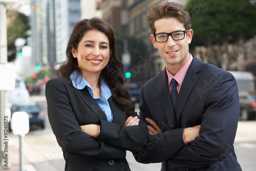 Portrait Of Businessman And Businesswoman Outside Office