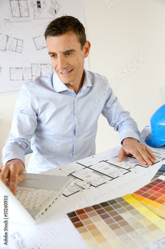 Architect working on laptop computer