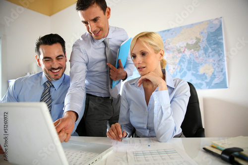 Business people meeting in office with laptop