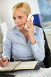 Businesswoman on the phone taking note on agenda