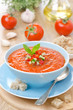 cold tomato soup gazpacho with basil in a bowl