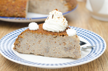piece of buckwheat cake (krupenik) with curd cream horizontal
