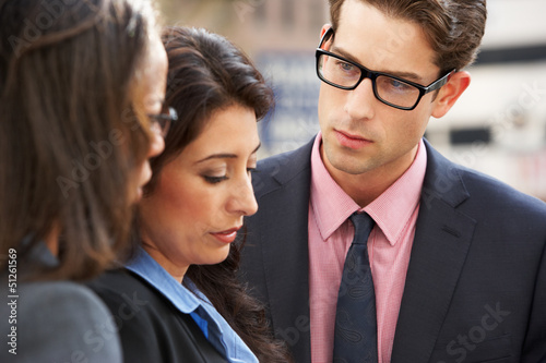 Businessman And Businesswomen Having Discussion In Street